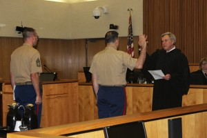 John Thomas takes the oath and is promoted to Major